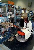 Civilian Ministry of Defense technician working on electronic equipment at RAF Sealand base - John Harris - 1990s,1998,agency,air transport,applied,armed forces,aviation,capitalism,capitalist,defence,defense,DERA,EBF Economy,ELECTRONIC,electronics,engineer,engineering,engineers,equipment,female,Industries,i