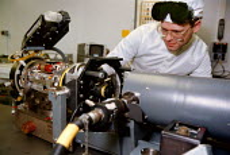 Civilian Ministry of Defense technician adjusting laser ranging equipment laboratory at RAF Sealand base - John Harris - 20-03-1998