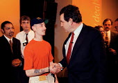 Gordon Brown Chancellor of the Exchequer shaking hands with a successful trainee at the launch of the Labour Party national Welfare to work initiative on welfare reform: the New Deal which will take 1... - John Harris - 1990s,1998,ethic,hands,jobless,jobseeker,jobseekers,LAB LBR work,launch,London,Marginalised,Party,people,pol politics,precariat,precarious,register,SERVICE,SERVICES,skilful,SKILL,SKILLED,skillful,SKIL