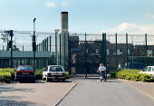 Campsfield House Detention Centre. Asylum seekers are held at the site outside Oxford which is staffed by Group 4 security guards - John Harris - 1990s,1998,Asylum Seeker,Asylum Seeker,bigotry,center,centre,CLJ law & justice,deportation,deportations,deporting,detained,detainee,detainees,detention,Detention Centre,Diaspora,DISCRIMINATION,displac