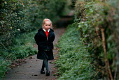 Child walking a footpath in the countryside after Junior school. - John Harris - 1990s,1998,country,countryside,EDU education,ENI environmental issues,female,females,footpath,footpaths,girl,girls,home,moody,nature,outdoors,outside,path,paths,RURAL,school,School Uniform,schools,sul