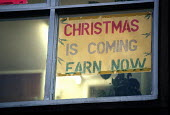 Sign offering work to earn money for Christmas in an Employment Agency window, Corby. The work offered is typically in a retail warehouse, distribution or food processing factory, low paid, insecure,... - John Harris - 06-11-1998