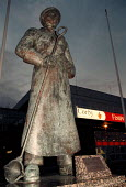 Statue of a steelworker erected on the 50th anniversary of the council, Corby (once a thriving steel town). - John Harris - 06-11-1998