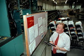 Manager at a Post office sorting office checking IMP automated sorting machine performance figures. - John Harris - 05-11-1998