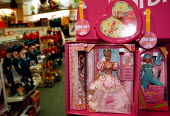 Barbie Doll toys on sale in a toy department of a High Street chain store as Christmas shopping has begun. They are made in China where wages are very low, where children and slave labor is thought to... - John Harris - 30-11-1998