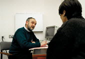 Doctor in consultation with patient at antenatal clinic in a Hospital - John Harris - 12-01-1999