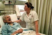 Health Care Assistant Auxiliary Nurse helping patient in geriatric care unit. Hospital Birmingham - John Harris - 13-01-1999