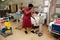 Domestic Ancillary staff cleaning a ward - geriatric care unit. Hospital Birmingham - John Harris - 13-01-1999