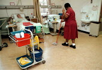 Domestic or Ancillary staff cleaning a ward - geriatric care unit. Hospital Birmingham - John Harris - 13-01-1999