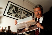 Exiled Chilean Student leader Sergio Requena Rueda MSF member who was tortured and by the Pinochet regime in Chile with a photo of the monument to the disappeared - John Harris - 22-01-1999