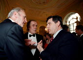 Gordon Brown MP Labour Chancellor of the Exchequer talking to wealthy industrialists and financiers at a charity function at the Bank of England in the City of London - John Harris - ,1990s,1999,AFFLUENCE,AFFLUENT,Bank,bank of England,BANKS,billionaire,billionaires,Bourgeoisie,businessman,businessmen,capitalism,capitalist,charitable,charity,class,communicating,communication,conver