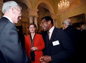 Bill Morris TGWU and Sarah Macauley talking to wealthy industrialists and financiers at a charity function at the Bank of England in the City of London - John Harris - 1990s,1999,AFFLUENCE,AFFLUENT,BAME,BAMEs,Bank,bank of England,BANKS,billionaire,billionaires,black,BME,BME Black minority ethnic,bmes,Bourgeoisie,Brown,businessman,businessmen,capitalism,capitalist,ch