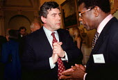 Gordon Brown MP Chancellor of the Exchequer talking to Bill Morris TGWU at a charity function attended by wealthy industrialists directors and financiers at the Bank of England in the City of London - John Harris - 1990s,1999,AFFLUENCE,AFFLUENT,BAME,BAMEs,Bank,BANKS,black,BME,BME Black minority ethnic,bmes,Bourgeoisie,charitable,charity,communicating,communication,conversation,cultural,dialogue,diversity,elite,e