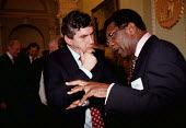 Gordon Brown MP Chancellor of the Exchequer talking to Bill Morris TGWU at a charity function attended by wealthy industrialists directors and financiers at the Bank of England in the City of London - John Harris - 1990s,1999,AFFLUENCE,AFFLUENT,Bank,BANKS,BME Black minority ethnic,Bourgeoisie,charitable,charity,communicating,communication,conversation,dialogue,elite,elitism,EQUALITY,giving,government,help,helpin