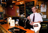 Pub landlord pouring a pint of larger - John Harris - 1990s,1999,Alcohol,bar,BAR PERSON,BAR STAFF,barman,barmen,BARS,drink,drinking,drinks,EBF business,EBF economy,job,jobs,LAB LBR work,male,man,men,people,person,persons,pint,pints,pouring,public,Public