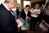 Patients and staff signing petitions organised by Unison as part of a Pay Protest Day against low pay for 400,000 clerical, administrative, professional and technical, ambulance and ancillary workers... - John Harris - 1990s,1999,activist,activists,against,campaign,campaigner,campaigners,Campaigning,CAMPAIGNS,clerical,DEMONSTRATING,DEMONSTRATION,DEMONSTRATIONS,EARNINGS,Fair,female,health,Hospital,HOSPITALS,interacti