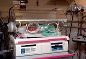Newborn baby boy in a hospital incubator in a Special Care Unit on the Labour Ward shortly after being born by emergence cesarian section operation. The baby is monitored and supplied with oxygen to h... - John Harris - 1990s,1999,apparatus,babies,baby,birth,born,caesarean,caesarean c-section,caesarian,care,cesarean,cesarian,cesarian caesarian,Child,Childbirth,CHILDHOOD,children,c-section,EARLY YEARS,Emilio,environme