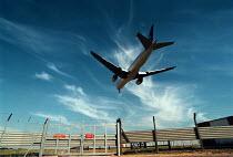 Passenger aeroplane landing at Heathrow Airport, one plane lands every 30 seconds - John Harris - 29-07-1999