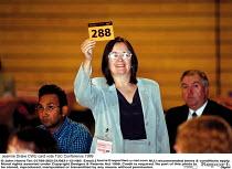 Jeannie Drake CWU card vote TUC Conference 1999 - John Harris - 1990s,1999,Conference,conferences,CWU,democracy,female,member,member members,members,people,trade union,trade union,trade unions,Trades Union,Trades Union,trades unions,TUC,vote,VOTES,voting,worker,wo