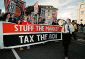 Protest and lobby organised by Socialist Workers Party outside the Labour Party Conference 1999 Banner reads Stuff the Market, Tax the Rich. - John Harris - 1990s,1999,activist,activists,anti capitalism,CAMPAIGN,campaigner,campaigners,CAMPAIGNING,CAMPAIGNS,capitalism,capitalist,Conference,conferences,DEMONSTRATING,Demonstration,DEMONSTRATIONS,Market,outsi