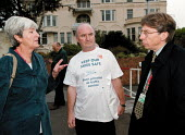 Keith Hill MP Junior Transport Minister being lobbied by IPMS trades union campaigning against the privatisation of Air Traffic Control outside the Labour Party Conference 1999 - John Harris - 29-09-1999