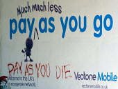 Graffiti on a mobile phone Pay as you Go advertisement Pay as you Die, after the World Health Organisation (WHO) WHO's International Agency for Research on Cancer listed the signals from wireless devi... - John Harris - 2010s,2011,advert,ADVERTISED,advertisement,advertisements,advertising,ADVERTISMENT,adverts,Agency,billboard,billboards,brain,call,calls,cancer,CANCERS,cell,CELLULAR,cities,city,communicating,communica