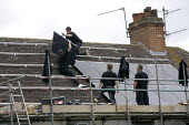 Installing Solar panels on the roof of 2 terraced houses rented for multiple occupancy, Stratford upon Avon, Warwickshire. - John Harris - 2010s,2011,accommodation,alternative,Alternative Energy,contractor,contractors,EBF,Economic,Economy,electric,ELECTRICAL,electricity,employee,employees,Employment,energy supply,engineer,engineers,eni,e