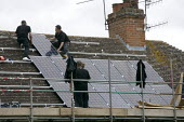 Installing Solar panels on the roof of 2 terraced houses, Stratford upon Avon, Warwickshire. - John Harris - 08-07-2011