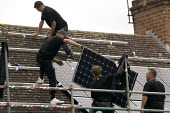 Installing Solar panels on the roof of 2 terraced houses rented for multiple occupancy, Stratford upon Avon, Warwickshire. - John Harris - 2010s,2011,accommodation,alternative,Alternative Energy,capitalism,capitalist,contractor,contractors,EBF,Economic,Economy,electric,ELECTRICAL,electricity,employee,employees,Employment,energy supply,en