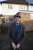 Pensioner outside his Housing Association home where he lives alone, Stratford upon Avon, Warwickshire. - John Harris - 2010s,2012,adult,adults,age,ageing population,alone,elderly,EMOTION,EMOTIONAL,EMOTIONS,EQUALITY,excluded,exclusion,flat cap,happiness,happy,HARDSHIP,hat,hats,home,house,houses,housing,Housing Estate,i