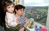 Kosovan refugee family housed in Red Road Flats, Springburn, Glasgow. Escaped from Viti a village in war torn Kosova. Iseni Sala (mother) is pictured with Laura the youngest of five children in their... - Jess Hurd - ,2000,2000s,adult,adults,and,Anxiety,Anxious,ANXIOUSNESS,APPREHENSIVE,Asylum Seeker,Asylum Seekers,Asylum Seeker,Asylum Seekers,BAME,BAMEs,bigotry,Black,BME,bmes,CARE,carer,carers,child,childcare,CHIL