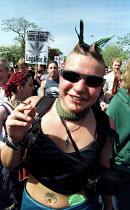 Demonstrator smokes a spliff on Legalise cannabis march through South London. - Jess Hurd - 2000,2000s,activist,activists,CAMPAIGN,campaigner,campaigners,CAMPAIGNING,CAMPAIGNS,cannabis,CIGARETTE,cigarettes,CLJ crime law,DEMONSTRATING,DEMONSTRATION,DEMONSTRATIONS,drug,drugs,female,getting hig