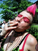 Punk demonstrator smokes a spliff on Legalise cannabis march through South London. - Jess Hurd - 07-05-2000
