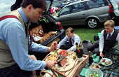 Royal Ascot racecourse, rich picnic in the car park before the racing with roast beef and champagne. - Jess Hurd - 23-06-2000