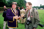 NUJ freelance photographer accepts a glass of champagne at Henley Royal Regatta. - Jess Hurd - 2000,2000s,ACE culture,AFFLUENCE,AFFLUENT,Alcohol,BlazerBoater,Bourgeoisie,champagne,CHAMPAIGN,drink,drinking,elite,elitism,EQUALITY,freelance,high,high income,income,INCOMES,INEQUALITY,LFL lifestyle