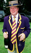 Member with a glass of champagne at Henley Royal Regatta. - Jess Hurd - 2000,2000s,ACE culture,AFFLUENCE,AFFLUENT,Alcohol,Blazer,Boater,Bourgeoisie,champagne,CHAMPAIGN,drink,drinking,elite,elitism,EQUALITY,high,high income,income,INCOMES,INEQUALITY,LFL lifestyle & leisure