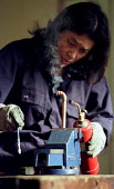 Unemployed women learn plumbing skills. Women's Education in Building (WEB) centre West London. - Jess Hurd - 2000s,2001,adult,Adult Education,adults,apprentice,Apprentices,apprenticeship,Blowtorch,building,BUILDINGS,capitalism,capitalist,cities,city,construction,course,edu Education,Education,female,Industri