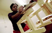 Unemployed women learn carpentry and joinery skills. Women's Education in Building (WEB) centre West London. - Jess Hurd - 2000s,2001,adult,Adult Education,adults,BAME,BAMEs,black,BME,bmes,building,BUILDINGS,capitalism,capitalist,carpenter,cities,city,construction,course,diversity,edu Education,Education,ethnic,ethnicity,