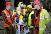 Construction workers protest about deaths on building sites. Each helmet represents a worker killed in 2000. Safety Summit, Queen Elizabeth Conf Centre, London - Jess Hurd - 27-02-2001