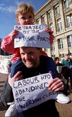 Birmingham UCATT member and his child join march for public services. - Jess Hurd - 03-03-2001