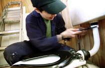 Unemployed women learn plumbing skills. Women's Education in Building (WEB) centre West London. - Jess Hurd - 2000s,2001,Adult Education,building,BUILDINGS,cities,city,Construction Industry,course,edu Education,Education,female,job,jobless,jobs,jobseeker,jobseekers,Lab Lbr Work,manual,Marginalised,people,pers