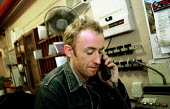 Technician on the phone Backstage, Chicargo at the Adelphi Theatre West End. - Jess Hurd - 06-03-2001