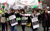 Protesters carry stretchers representing Palestinians killed by Israeli army. March for Palestinian rights, London - Jess Hurd - 17-03-2001