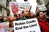 Protesters wear Robin Cook beards and Pinocchio noses to protest against economic sanctions on Iraq, Downing Street, Westminster. - Jess Hurd - 29-04-2001