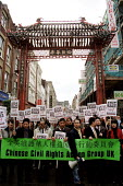 Chinese Civil Rights Action Group protest march against the MAFF allegation that the source of Foot and Mouth disease was illegally smuggled meat supplied to a Chinese restaurant. Soho, London. - Jess Hurd - 2000s,2001,activist,activists,against,and,animal health,bigotry,CAMPAIGN,campaigner,campaigners,CAMPAIGNING,CAMPAIGNS,Chinese,control,DEFRA,DEMONSTRATING,DEMONSTRATION,DEMONSTRATIONS,DISCRIMINATION,di