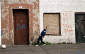 Children play football, derelict council housing estate, Niddrie, East Edinburgh, Scotland. - Jess Hurd - ,2000s,2001,adolescence,adolescent,adolescents,bad,boy,boys,child,CHILDHOOD,Children,council,derelict,DERELICTION,EQUALITY,excluded,exclusion,football,graffiti,HARDSHIP,housing,impoverished,impoverish