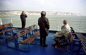 British tourists view the White Cliffs of Dover from the deck of a ferry whilst on a day trip to Calais, France. - Jess Hurd - 12-04-2001