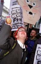 May Day Monopoly Anti Capitalist protest World Bank, Haymarket, London. Drop third world debt. - Jess Hurd - 2000s,2001,activist,activists,against,anti,Bank,BANKS,CAMPAIGN,campaigner,campaigners,CAMPAIGNING,CAMPAIGNS,capitalism,capitalist,corporation,DEMONSTRATING,DEMONSTRATION,DEMONSTRATIONS,globalisation,G