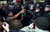 Confrontation with Metropolitan riot police after they baton charge penned-in demonstrators. May Day Monopoly Anti Capitalist protest Oxford Circus, London. - Jess Hurd - 2000s,2001,Accusation,accusingly,activist,activists,adult,adults,against,anti,baton,batons,CAMPAIGN,campaigner,campaigners,CAMPAIGNING,CAMPAIGNS,capitalism,capitalist,clj crime law and justice,communi