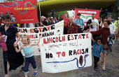 Lincoln estate anti racist and trades union banners on funeral march for Shiblu Rahman, East London. Murdered by racists 01/04/01. - Jess Hurd - 27-05-2001